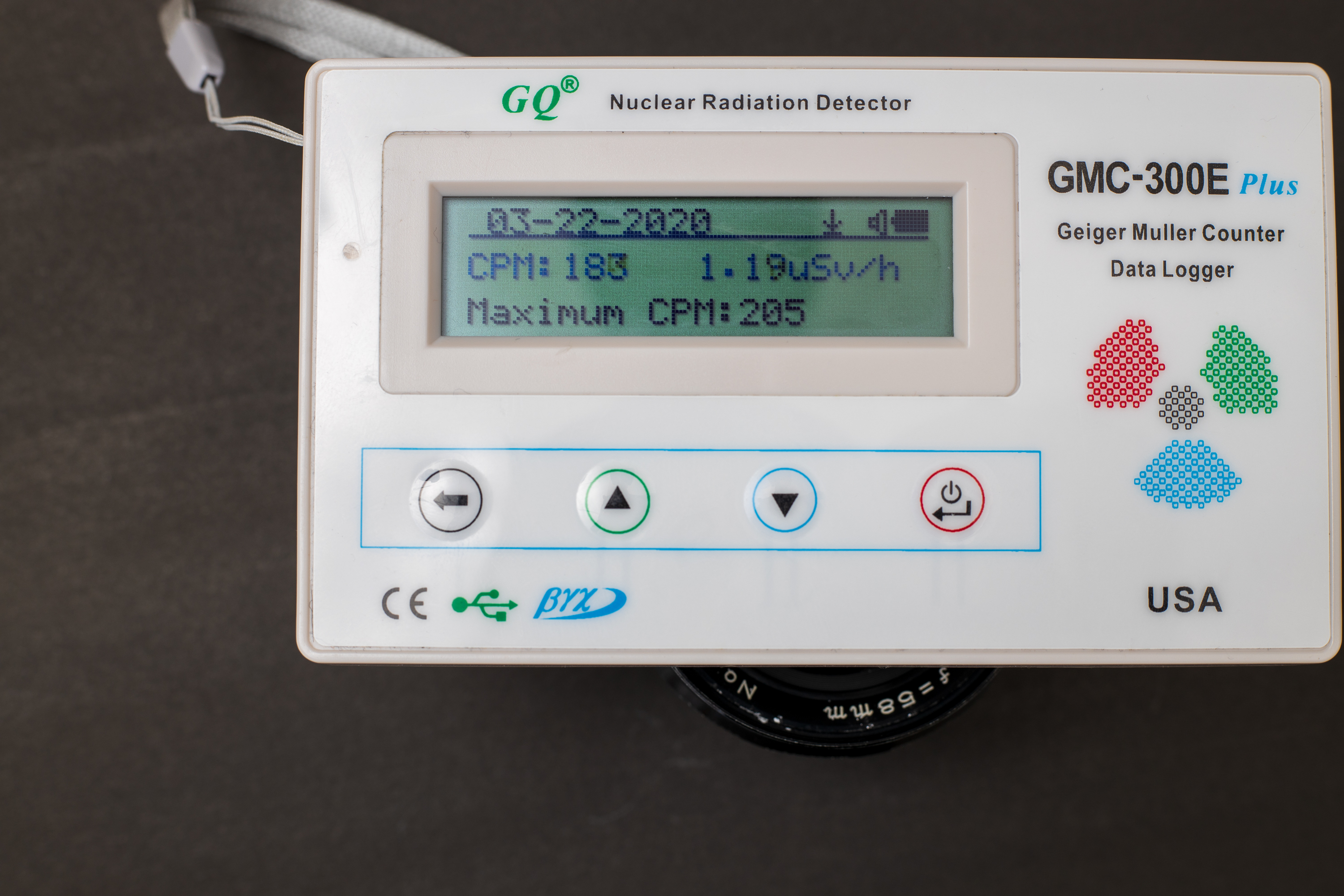 Geiger counter registering 1.19 uSv/h for front of Mamiya Sekor 58mm f1.7 M42
